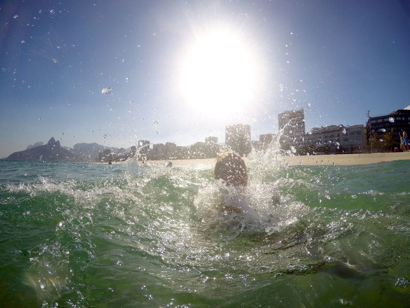 In The Water Rio De Janeiro Adventures In The City Architecture Beauty In Nature Bright Day Hitting Ipanema Lens Flare Motion Nature Outdoors Power In Nature Sea Sky Splashing Sport Spraying Sun Sunlight Sunny Water Waterfront Wave