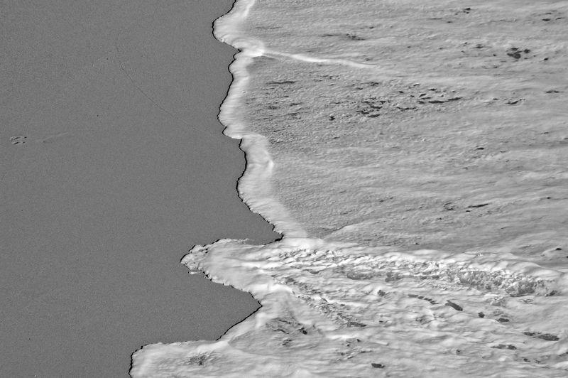 Close-up of ice on beach