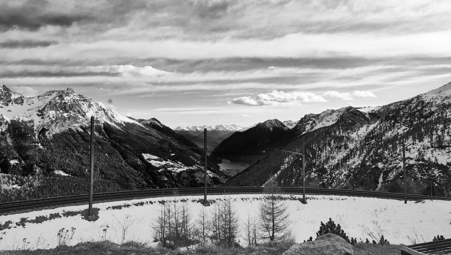 Mountain Nature Beauty In Nature Cloud - Sky Landscape Scenics Outdoors Snow Sky Day No People Winter Tranquil Scene Cold Temperature Railway Track Bernina Express Black And White Blackandwhite Black & White Blackandwhite Photography Lake Swiss Alps Switzerland