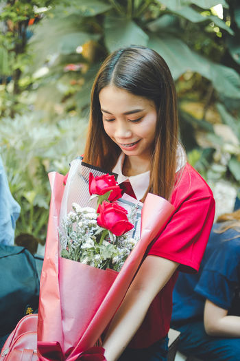 Young woman holding flower bouquet