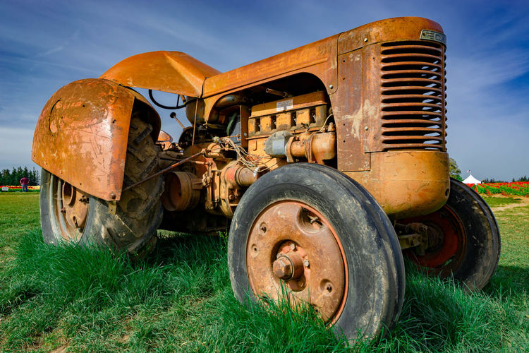 Abandoned Field Grass Transportation Land Mode Of Transportation Nature Rusty Obsolete Land Vehicle Metal Day Plant Old Decline Damaged No People Sky Deterioration Stationary Outdoors