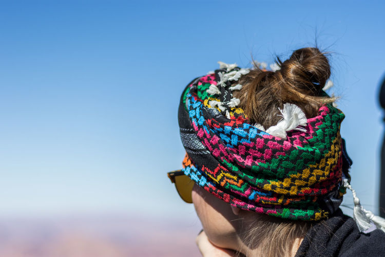Woman wearing headscarf against clear sky