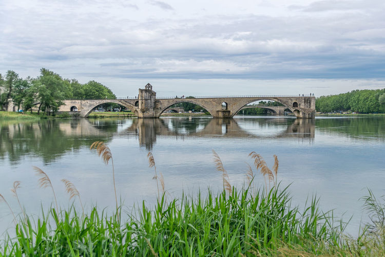 Avignon, City of Pont d´Avignon Architecture Sky Built Structure Cloud - Sky Nature Day Outdoors No People Water Bridge Plant Bridge - Man Made Structure Connection Grass Reflection River Arch Arch Bridge Beauty In Nature Transportation Tranquility