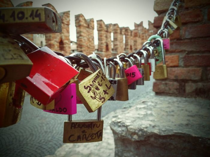 Focus On Foreground Text Padlock Western Script Lock Close-up Building Exterior Love City Hanging Built Structure Railing Architecture Water Symbol Luck Outdoors City Street Canal Message