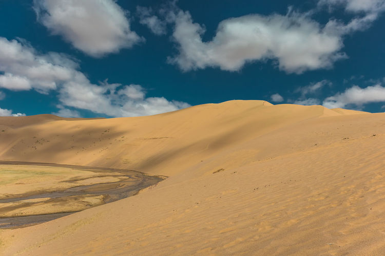 Mongolia Cloud - Sky Scenics - Nature Sky Desert Landscape Sand Tranquil Scene Tranquility Environment Beauty In Nature Sand Dune Land Climate Non-urban Scene Arid Climate Nature Remote Day No People Idyllic Outdoors Atmospheric