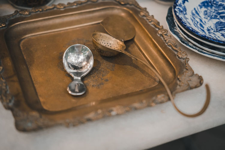 Table Indoors  Antique Old No People Close-up Selective Focus Still Life High Angle View History Metal The Past Kitchen Utensil Group Of Objects Wood - Material Household Equipment Nostalgia Art And Craft Retro Styled Tray Setting Silver Colored Luxury