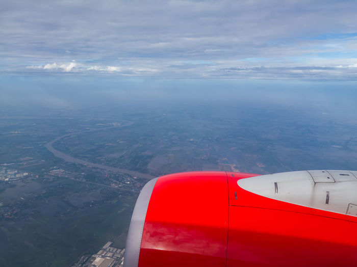 In the Air Aerial View Air Vehicle Aircraft Wing Airplane Airplane Wing Beauty In Nature Cloud - Sky Day Flying Jet Engine Journey Landscape Mid-air Mode Of Transport Nature No People Outdoors Scenics Sea Sky Tranquility Transportation Travel Vehicle Part