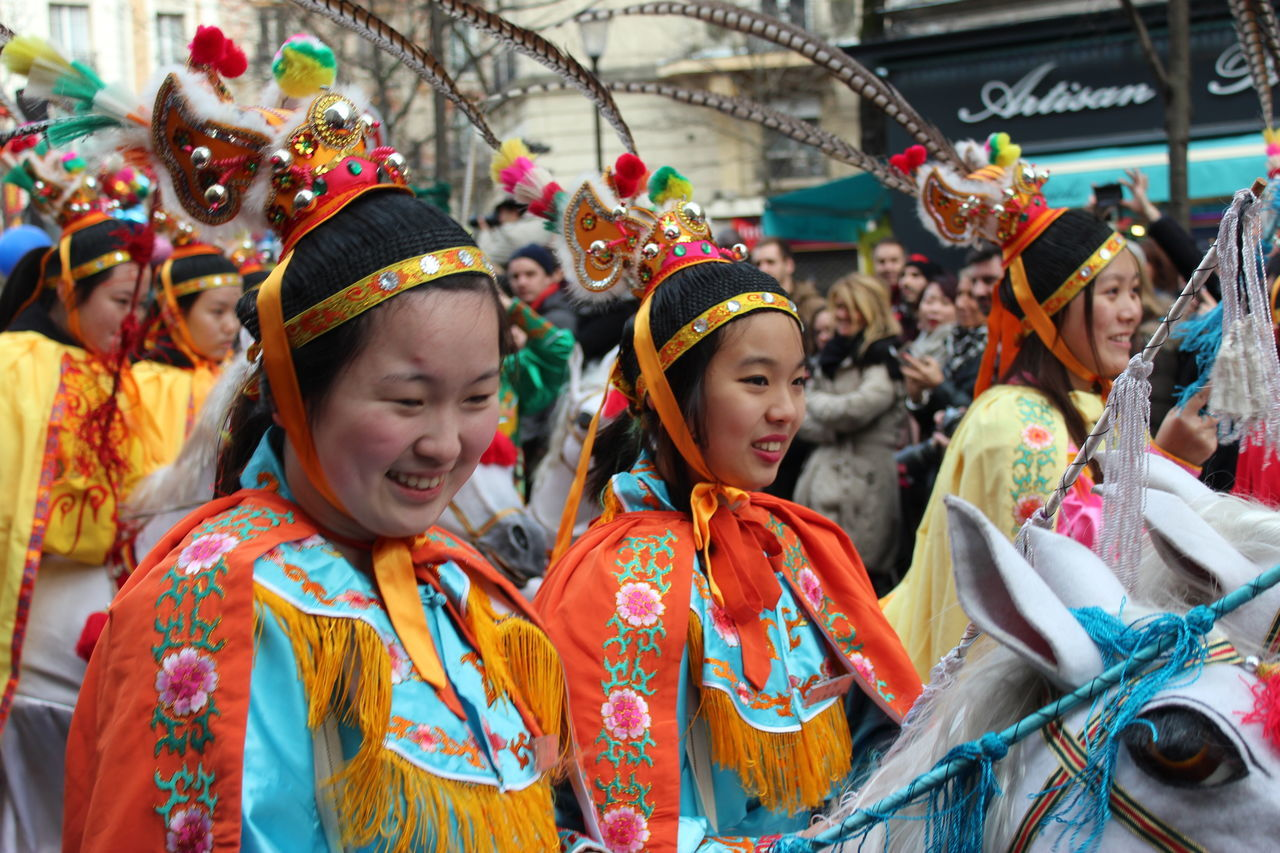 real people, traditional clothing, celebration, cultures, costume, traditional festival, arts culture and entertainment, tradition, traditional dancing, performance, togetherness, lifestyles, multi colored, outdoors, leisure activity, day, large group of people, standing, childhood, people