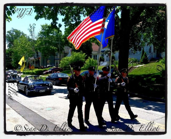 Norwich police color guard lead Memorial Day parade down Broadway.