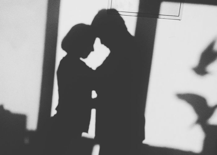 Shadow of man and woman standing on floor