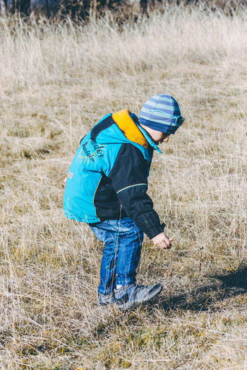 Boys Childhood Day Field Full Length Grass Nature One Boy Only One Person Outdoors People Real People Warm Clothing