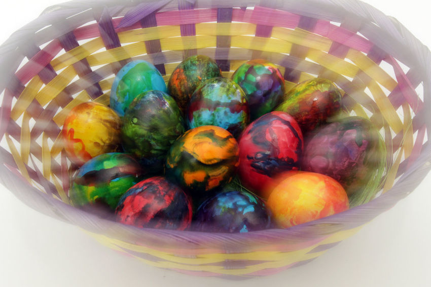 Easter eggs. Photo in motion effects during shooting. Not post process. Handmade painted eggs in basket for Easter celebration isolated on white background. Easter. Colored Easter eggs. Christianity Colored Colors Easter Easter Egg Holiday Jesus Christ Motion Blur Motion Photo Motion Shot Tradition Cultures Decoration Eastereggs Egg Eggs Handmade Motion Capture Motion Photography Painted Image Pianted This