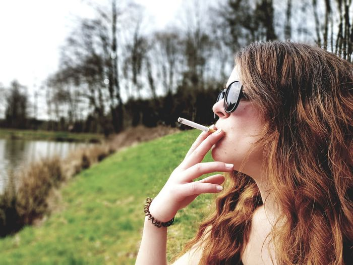 Green Trees Nature Sunny Day Lake Water Young Women Tree Women Holding Sky Grass Close-up Smoking Cigarette  Sunglasses The Portraitist - 2018 EyeEm Awards