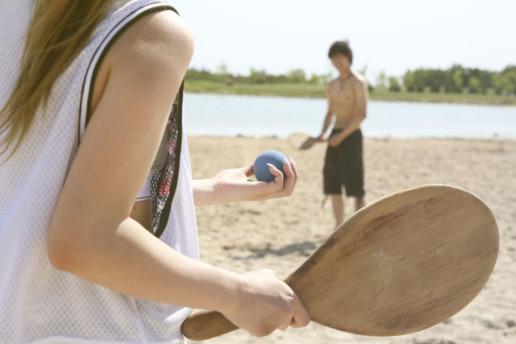 Friends playing fresco ball at the Beach in a sunny Couple Freedom Friends Fun Holiday Sunny Winnipeg Adventure Beach Beach Tennis Birds Hill Provincial Park Close Up Fresco Ball Friendship Game Healthy Lifestyle Lifestyles People Relax Selective Focus Sport Summer Tourism Vacation Young Adult