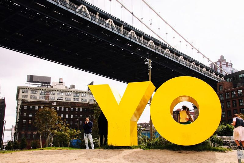 Paint The Town Yellow Architecture Real People Built Structure Men Lifestyles New York City DUMBO, Brooklyn Outdoors Day City Standing Sky Adult People
