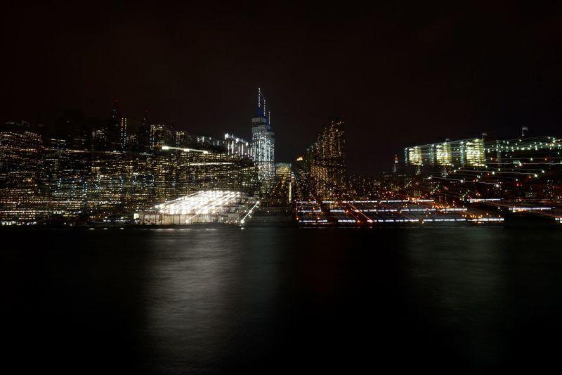 Illuminated blurred skyline at night