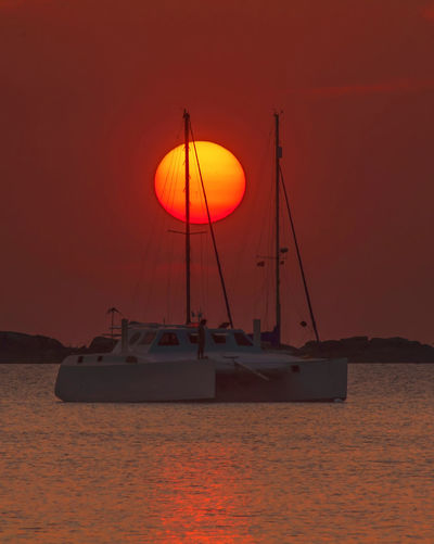 Sailboat over the sunset Sailboat In Sunset Sunset_collection Beach Beauty In Nature Day Horizon Over Water Mode Of Transport Moored Nature Nautical Vessel No People Orange Color Outdoors Sailboat Sailboats Scenics Sea Sky Sunset Sunsets Tranquility Transportation Water EyeEmNewHere