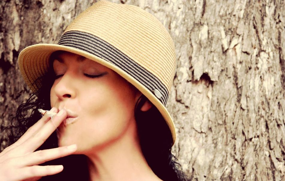 cannabis daydreams Marijuana Cannabis Plant Inhale Pot Grass Cannabis 420 Weed Herb Reefer Beauty In Nature Emotion Face Beach Simple Photography Young Women Headshot Sun Hat Women Portrait Hat Close-up Idyllic Scenics Shore Tree Trunk Smoking #urbanana: The Urban Playground Be Brave