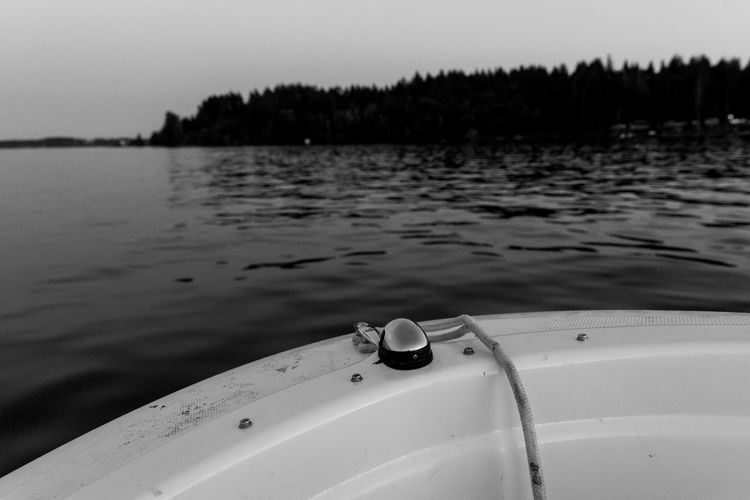 Close-up of boat on lake against sky
