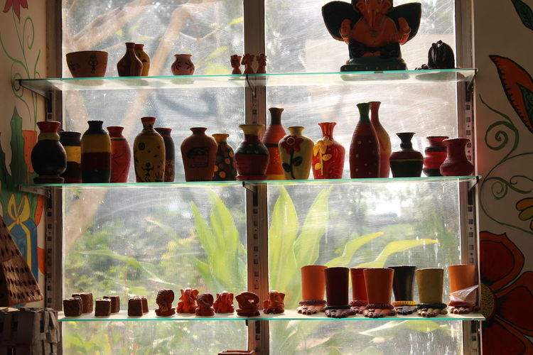 Art Light Light And Shadow Colors Art Mumbai India Indian Shine Architecture Glass Material Mud Terracotta Handmade Shelf Arrangement Variation Various Display Shop Raw For Sale Window Display Shelves Collection Variety Collage Stall