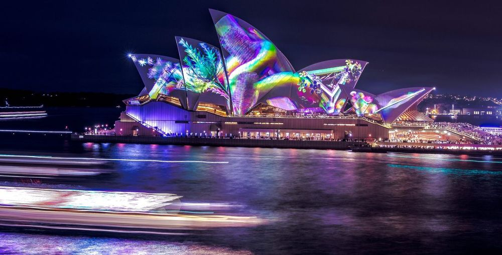 Vivid 2018 Photograpghy Sydney Opera House Night Illuminated Sky Water Multi Colored Architecture Building Exterior Built Structure Motion City No People Nightlife Glowing Light Nature Reflection
