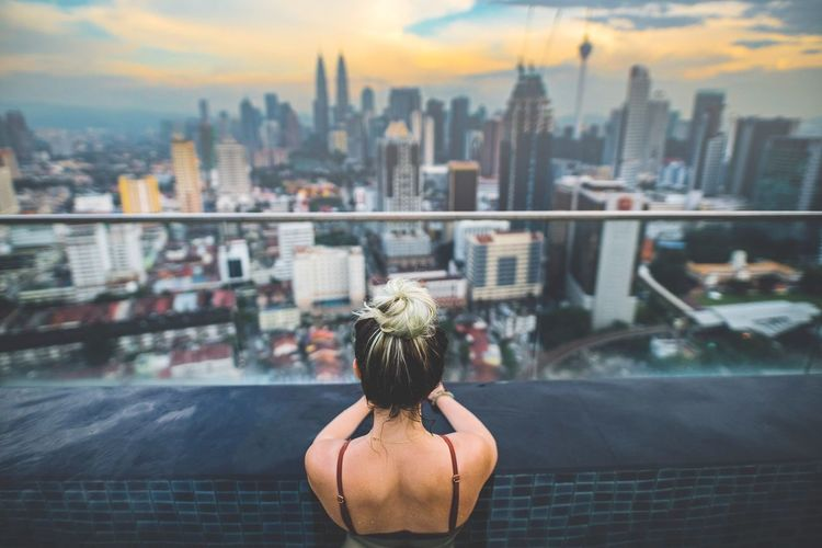 Rear view of woman looking at kuala lumpur city view
