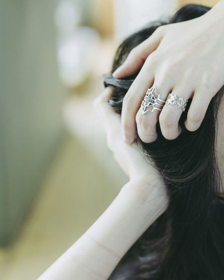 Cropped Image Of Woman With Hands In Hair
