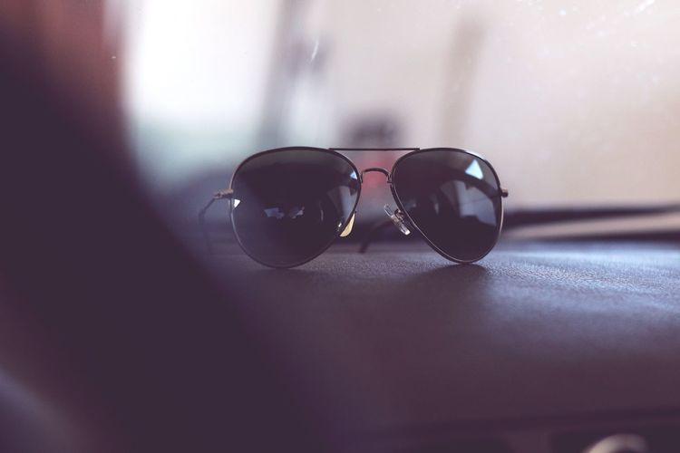 Close-up of sunglasses on seat