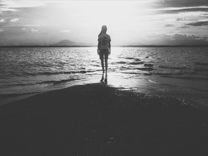 Traveling Home For The Holidays Beach People Sea Horizon Over Water Real People Water One Person Nature Outdoors Silhouette Rear View Full Length Reflection Leisure Activity Lifestyles Sky Beauty In Nature Adult Day First Eyeem Photo EyeEmNewHere Blackandwhite Jin BTS