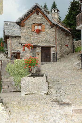 Quite and peace in italian alps village Alps Italy Calm Architecture Building Exterior Built Structure Day House Mountain Nature No People No People, Outdoors Plant Quite Place Residential Building Silence Sky Traditional Traditional Building Tree