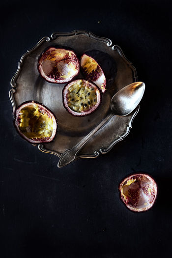 High angle view of passion fruits in bowl on table