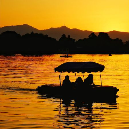 Sunset Silhouette Lake Reflection Water Mountain Nature Outdoors Yellow Scenics Warm Glow Hangzhou,China Lake View West Lake, Hangzhou Travel Light And Shadow FUJIFILM X-T10 China View Beauty In Nature Landscape Vacations Tranquility Mountain Range Floating On Water Travel Destinations