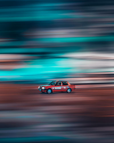 Blurred motion of toy car on road
