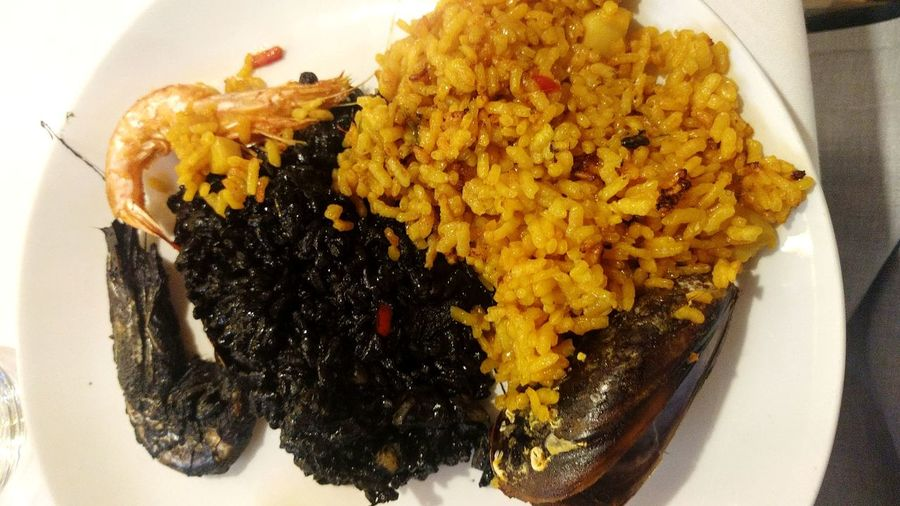 Paella and black rise 🤤😋 Food And Drink Food Ready-to-eat Plate Freshness No People Indoors  Serving Size Indulgence Table Healthy Eating Close-up Comfort Food Paella 🥘 Spanish Spain ✈️🇪🇸 Spanish Food Gran Via, Madrid Foodporn Squid Fishing Squid Shrimps