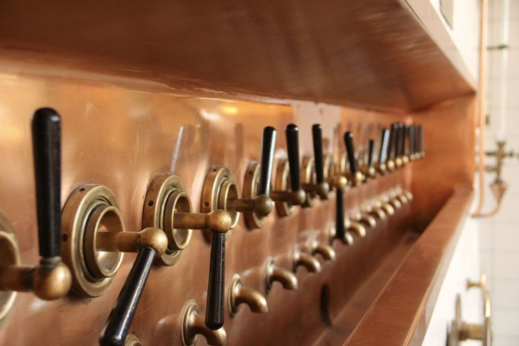 Close-up of beer taps in distillery