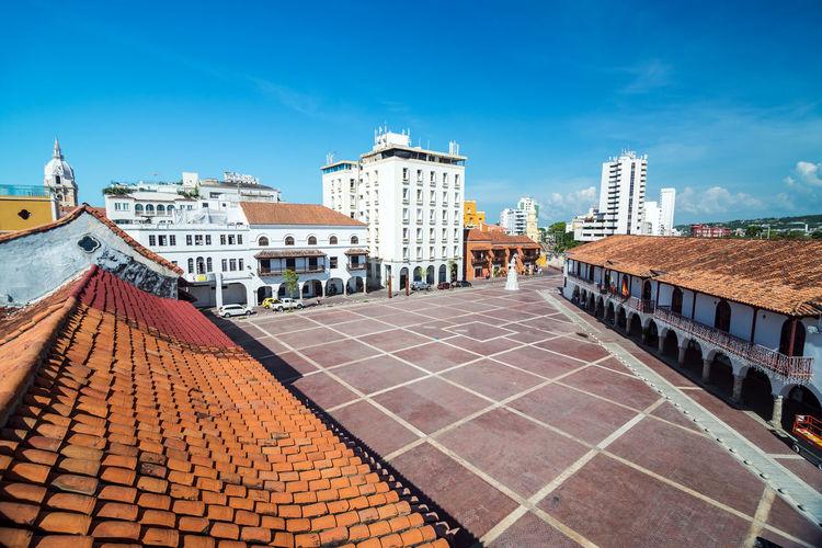 Buildings By Plaza De La Aduana Against Blue Sky