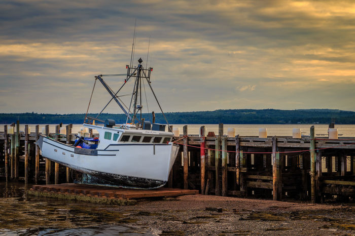 Fishing Boat in Dry Dock Bay Of Fundy Dry Dock Fishing Harbor New Brunswick, Canada St Andrews By The Sea Canada Canada Fishing Boat Low Tide