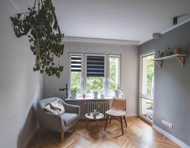 Chairs and table at home against building