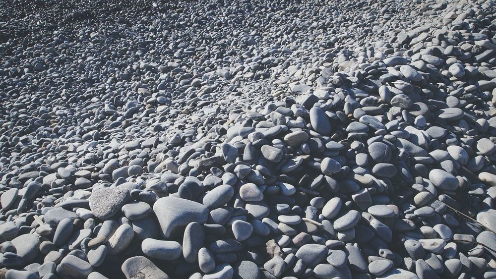 Stony waves Stones Beach Winter Abstract Infinity Nopattern Chaos Close-up Disposition Grey Rounded Stones Heavy No People Outdoors DaySeaside Nice EyeEm Best Shots EyeEm Gallery Eye4photography  The Great Outdoors - 2017 EyeEm Awards