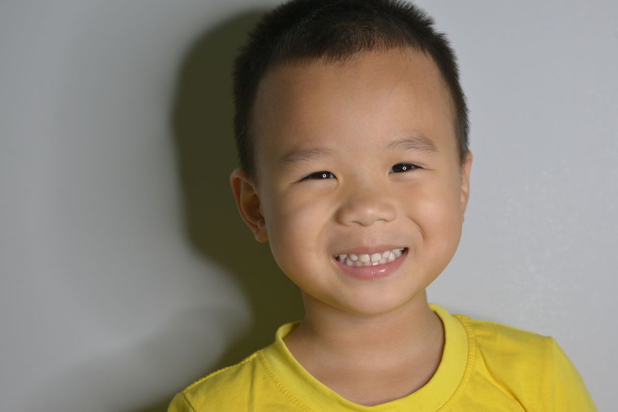 Boys Casual Clothing Child Childhood Close-up Cute Emotion Front View Happiness Headshot Indoors  Innocence Looking At Camera One Person Portrait Smiling Studio Shot