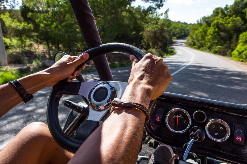Enjoy the ride! Ibiza Buggy Road Journey Human Hand Water Adventure Men Journey Close-up Sky Travel Steering Wheel Car Interior Gearshift Vehicle Interior Car Point Of View