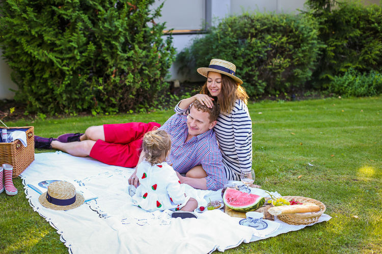 Parents with daughter enjoying picnic in park