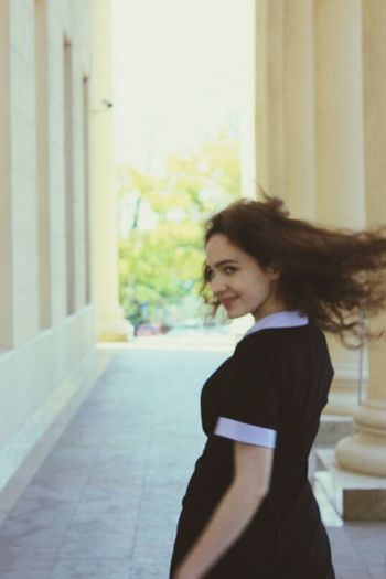 One Person One Woman Only Only Women Day Young Adult City Women Lifestyles People Brown Hair Real People Beauty Curly Hair Long Hair Architecture City Sky Russia Smiling Portrait Arts Culture And Entertainment