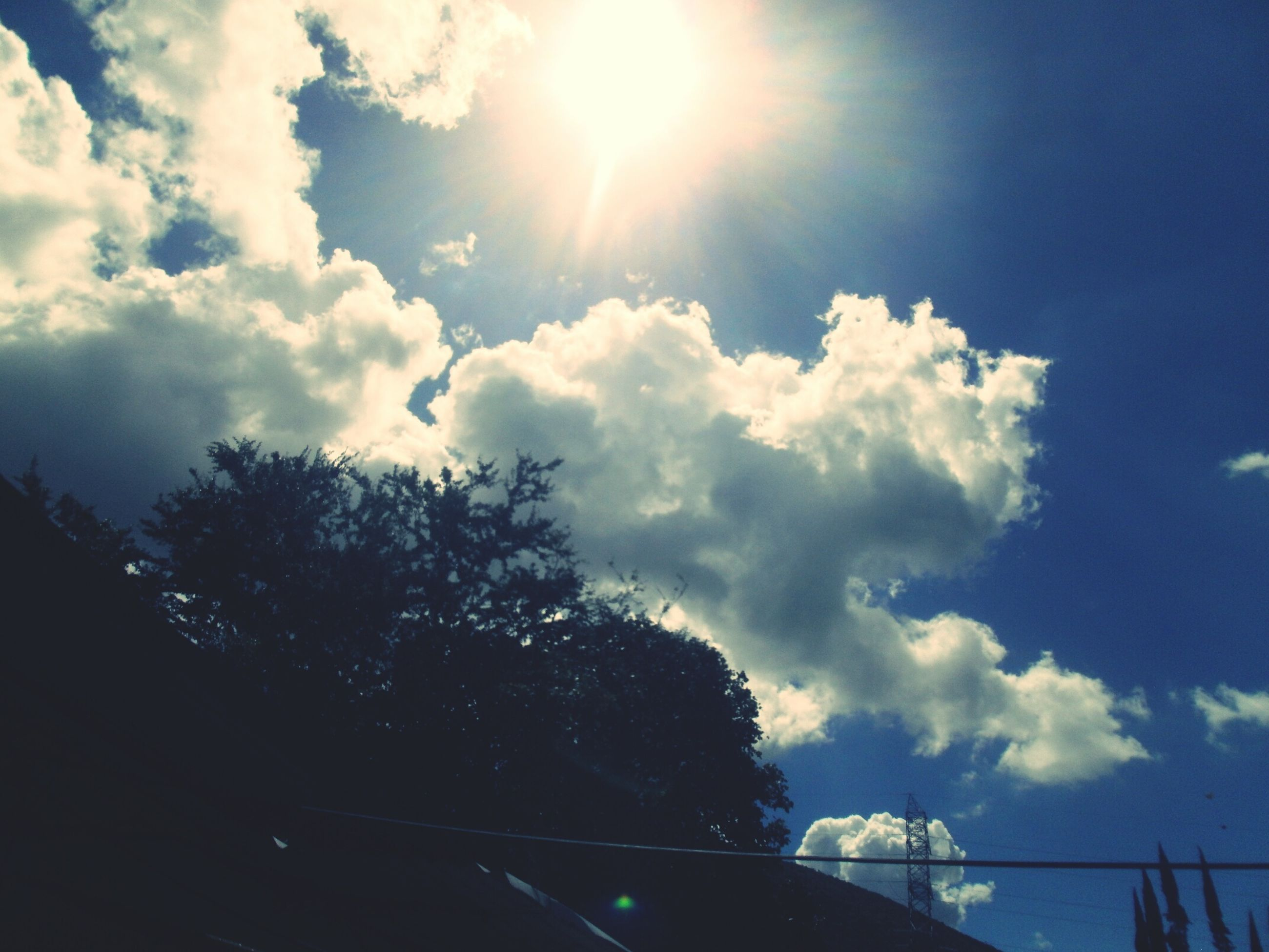 sun, sky, sunbeam, sunlight, low angle view, cloud - sky, silhouette, lens flare, tree, cloud, nature, sunny, beauty in nature, tranquility, blue, bright, day, tranquil scene, scenics, outdoors