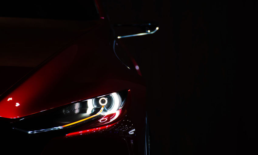 Night Indoors  Close-up No People Music Arts Culture And Entertainment Illuminated Nightlife Red Technology Dark Copy Space Nightclub Car Motor Vehicle Black Background Land Vehicle Studio Shot Record New Front Bumper Headlight