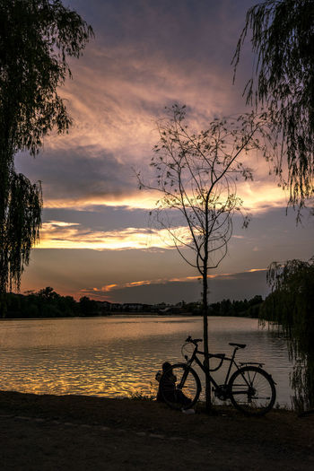 EyeEm Best Shots EyeEm Nature Lover Meditation Relaxing Beauty In Nature Bicycle Cloud - Sky Eyeemgermany Idyllic Lake Mode Of Transportation Nature Non-urban Scene Orange Color Outdoors Plant Scenics - Nature Silhouette Sky Sunset Tranquil Scene Tranquility Transportation Tree Water