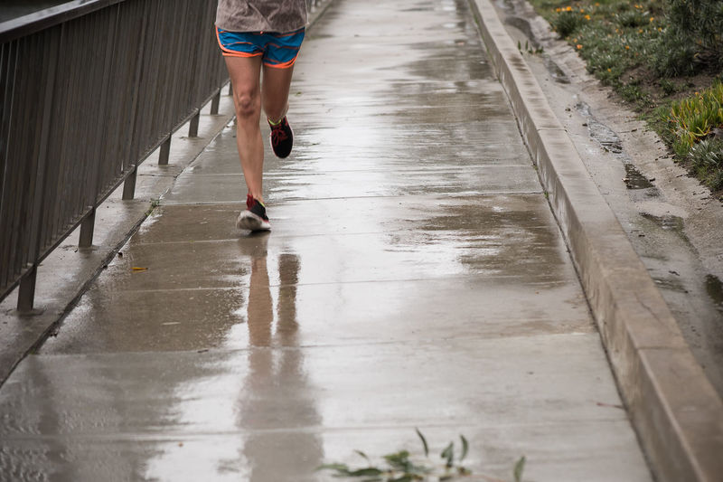 running partner Exercising Reflection Running Healthy Lifestyle Human Leg Lifestyles Low Section One Person Outdoors Puddle Real People Water Wet Young Adult Young Women