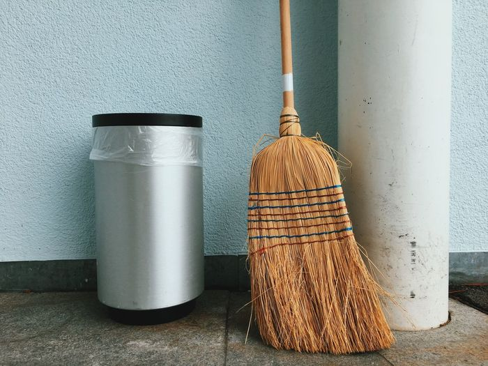 Close-up of trashcan and broom