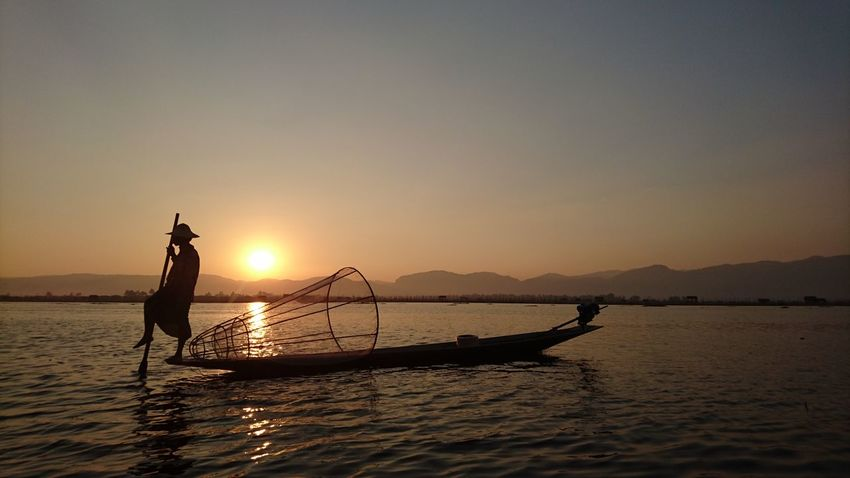 After a long day around villages and temples, here is the amazing sunset with the typical Fisher man on Inle Lake . Silvia In Myanmar Sunset Sunset Hunter Fisherman Sunset Silhouettes Myanmar Silhouette On The Way 43 Golden Moments My Year My View