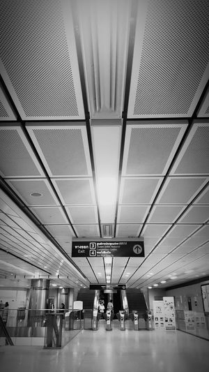 Subway Station Perspective Line Life Perspectivephotography Transportation Indoors  Travel Ceiling Airport Railroad Station Journey Transportation Building - Type Of Building People Architecture Airport Departure Area Day Business Finance And Industry Travel Destinations MRT In Bangkok MRT !  Transportation Terminal Black And White Friday
